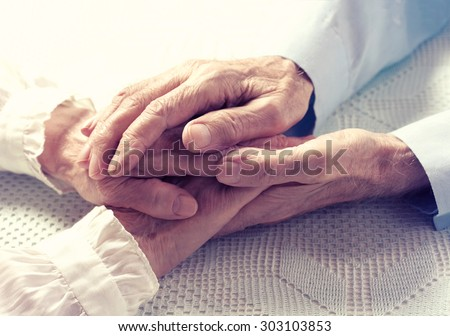 Old people couple holding hands closeup. Happy family.