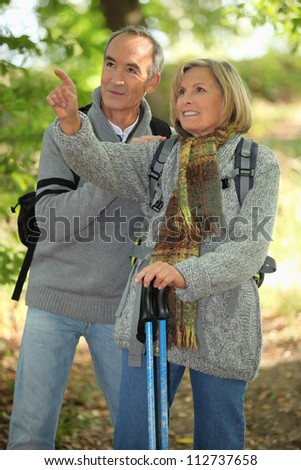 Old people hiking - stock photo