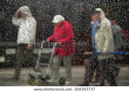 old people in the rain