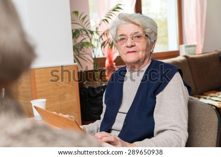 Old people playing rummy together - stock photo