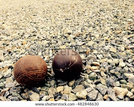 old Petanque ball  or Metallic petanque balls on fine stone field.