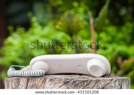 Old phone on wooden. - stock photo