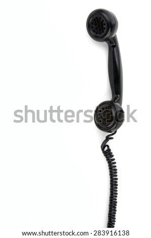 Old phone receiver - stock photo