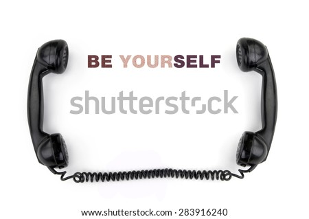 Old phone receiver with inscription be yourself - stock photo