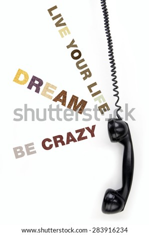 Old phone receiver with inscription dream - stock photo