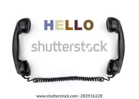 Old phone receiver with inscription hello - stock photo