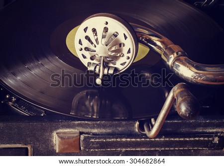 old phonograph with vinyl records, retro style - stock photo
