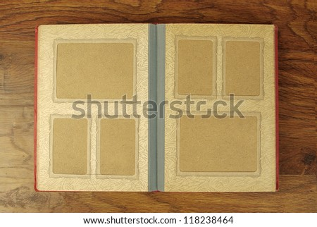 Old photo-album on wooden background - stock photo