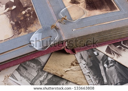 Old Photo album with Photos and Pince-nez - stock photo