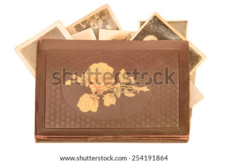 Old photo-album with retro pictures inside it on white background. - stock photo