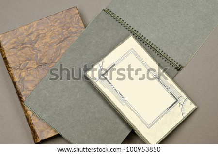 Old photo albums with cardboard picture frame. - stock photo