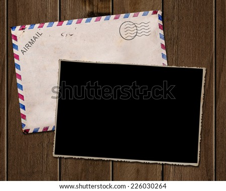 Old photo and envelope on wooden table. - stock photo