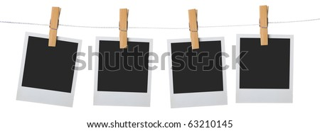 old photo frame attach to rope clothes peg over white background - stock photo