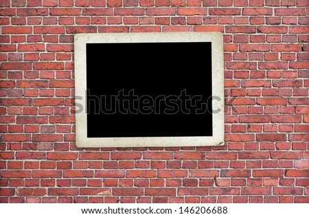 old photo frame on brick wall  - stock photo