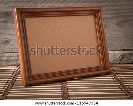 old photo frame on the village background - stock photo