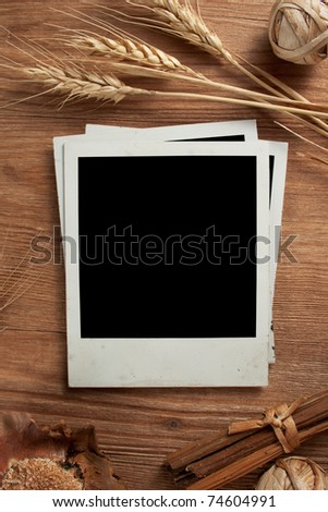 Old photo frames on wood background with wheat - stock photo
