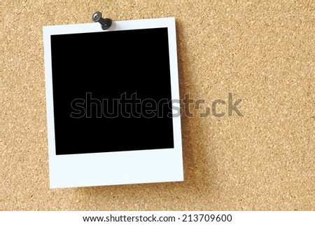 old photo on cork bulletin board - stock photo