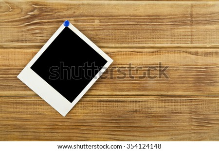 old photo on wooden background - stock photo