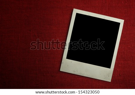 Old photo paper on fabric with clipping path for the inside - stock photo