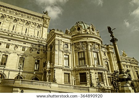 Old photo with architectural details of Opera National de Paris: Front Facade. Grand Opera (Garnier Palace) is famous neo-baroque building in Paris, France. Vintage processing. - stock photo