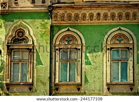 Old photo with architectural details on a historic building in Union Square, Timisoara, Romania. Image digitally manipulated as one old photo. - stock photo