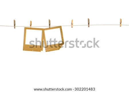 Old photoframes are hanging in the row  isolated on white background
