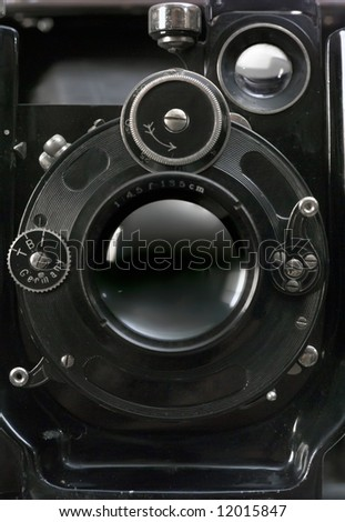 Old photographic camera with lens of bellows. Front view. - stock photo
