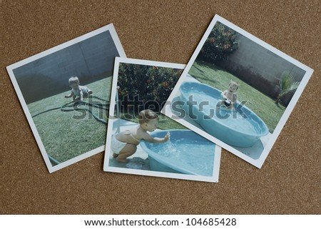 Old photographs from the 1960's of a baby girl playing in a backyard pool on a bulletin board. - stock photo