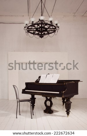 Old piano in a vintage interior - stock photo