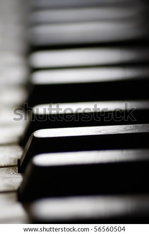 Old piano keys close up, selective focus