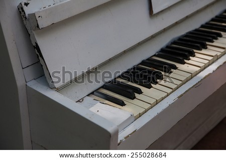 Old piano keys in black and white color, music photo - stock photo