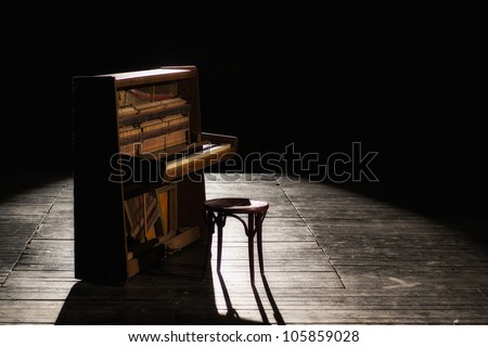 Old piano on the stage - stock photo