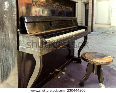 Old piano on the street available for passers by - stock photo