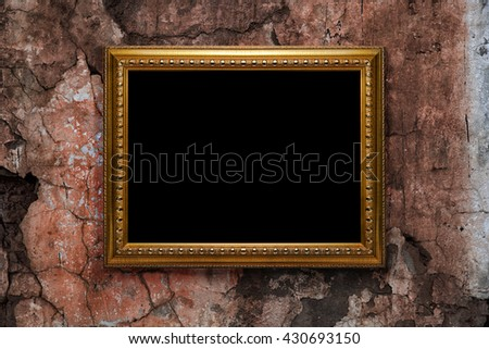 old picture frame on  vintage wall - stock photo
