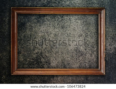 Old picture frame on wall to put your own pictures in. - stock photo