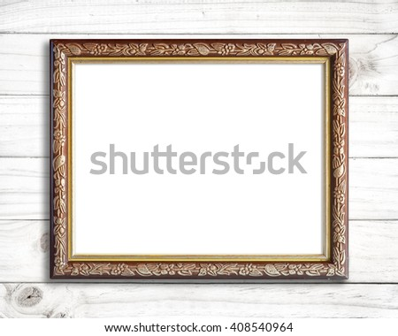 Old picture frame on white wood wall. - stock photo