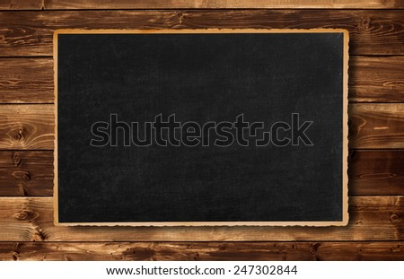 old picture frame on wood background - stock photo