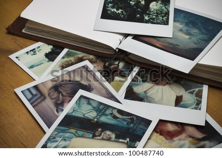 Old pictures and a journal. - stock photo