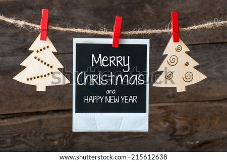 Old pictures on wood background with Christmas decoration.Wooden christmas tree hanging with old picture on rope ant lettering Marry Christmas and Happy new year - stock photo