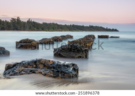 Old pier on the island of Kauai.  Shot with long exposure to smooth out crashing waves & give a dreamy effect. - stock photo