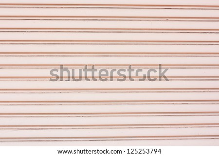 Old pink metal roller shutter use as background or textures - stock photo