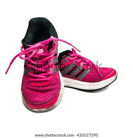 Old pink sneakers, Sports shoes isolated on white background - stock photo