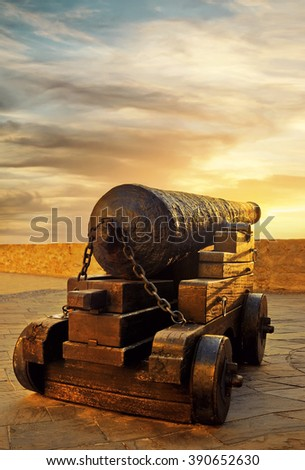 old pirate gun on nuclei at sunset