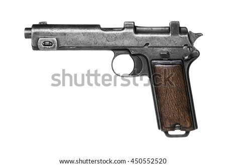 Old pistol isolated on white background - stock photo
