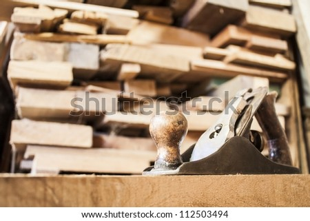 Old plane with planks on background - stock photo