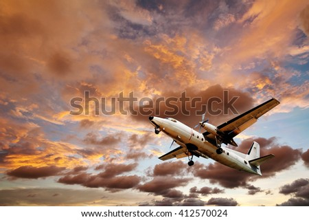 Old plane with sky sunset and cloud storm in twilight - stock photo