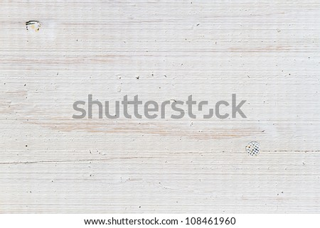 Old plank with nails painted on white - stock photo