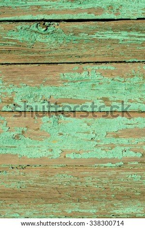 Old planks painted turquoise copyspace - stock photo