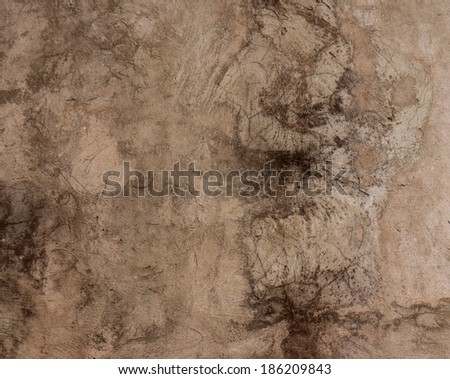 old plaster surface covered with scratches and cracks