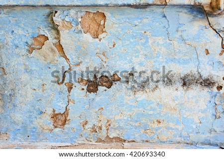 old plaster wall with cracks background - stock photo